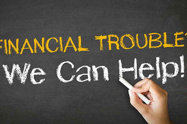 "Chalkboard that says ""Financial trouble? We can help!"""